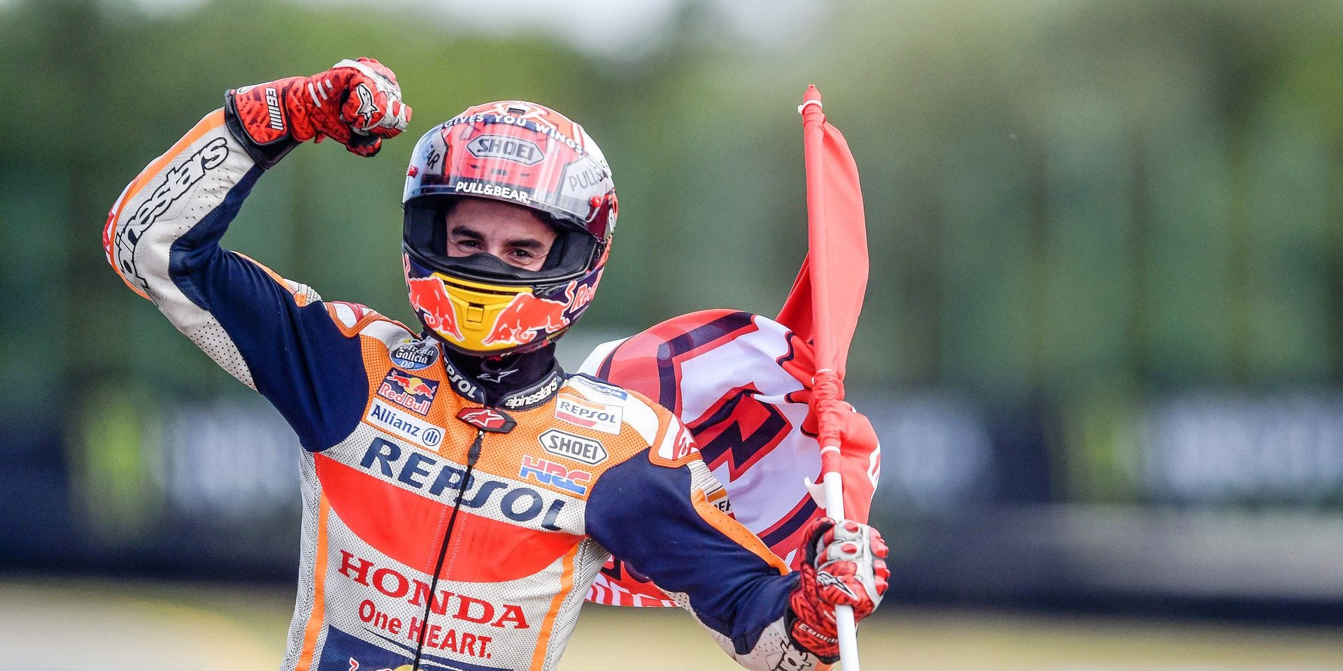 TOPSHOT - Winner Repsol Honda Team's Spanish rider Marc Marquez celebrates after the Moto GP Czech Grand Prix in Brno on August 4, 2019. (Photo by Michal CIZEK / AFP)