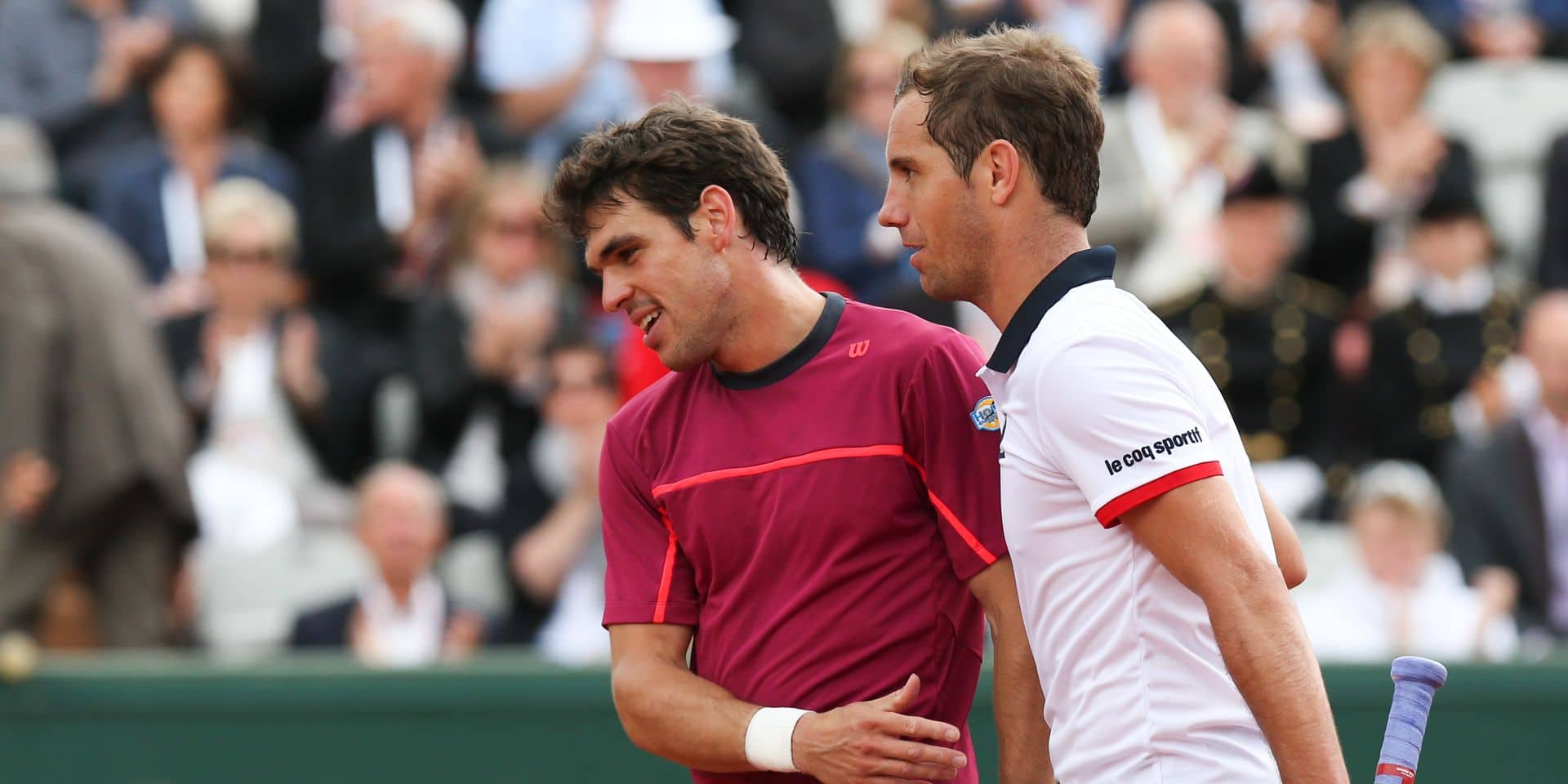 20150526 - PARIS, FRANCE: Belgian Germain Gigounon and French Richard Gasquet shake hands at the end of the first round game of the men's singles tournament at the Roland Garros tennis tournament, between Belgian Germain Gigounon and French Richard Gasquet, in Paris, France, Tuesday 26 May 2015. Roland Garros Grand Slam takes place from 24 May to 07 June 2015. BELGA PHOTO VIRGINIE LEFOUR