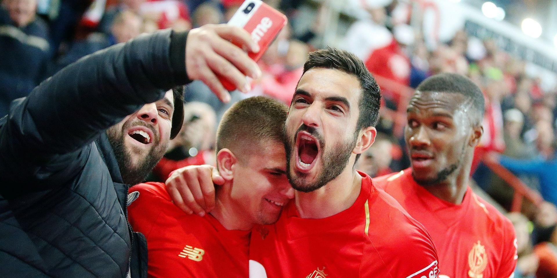 Standard's Razvan Marin and Standard's Konstantinos Kostas Laifis celebrate during a soccer match between Standard de Liege and Club Brugge, Thursday 16 May 2019 in Liege, on day 9 (out of 10) of the Play-off 1 of the 'Jupiler Pro League' Belgian soccer championship. BELGA PHOTO BRUNO FAHY
