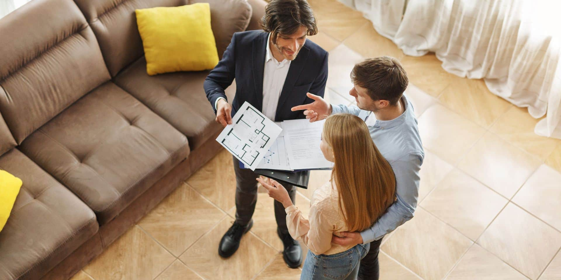 Above,View,Of,Real,Estate,Agent,Communicating,With,Customers,About