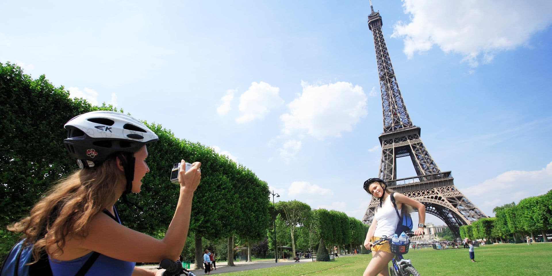 France, Paris, woman taking picture of other woman, Eiffel tower in background