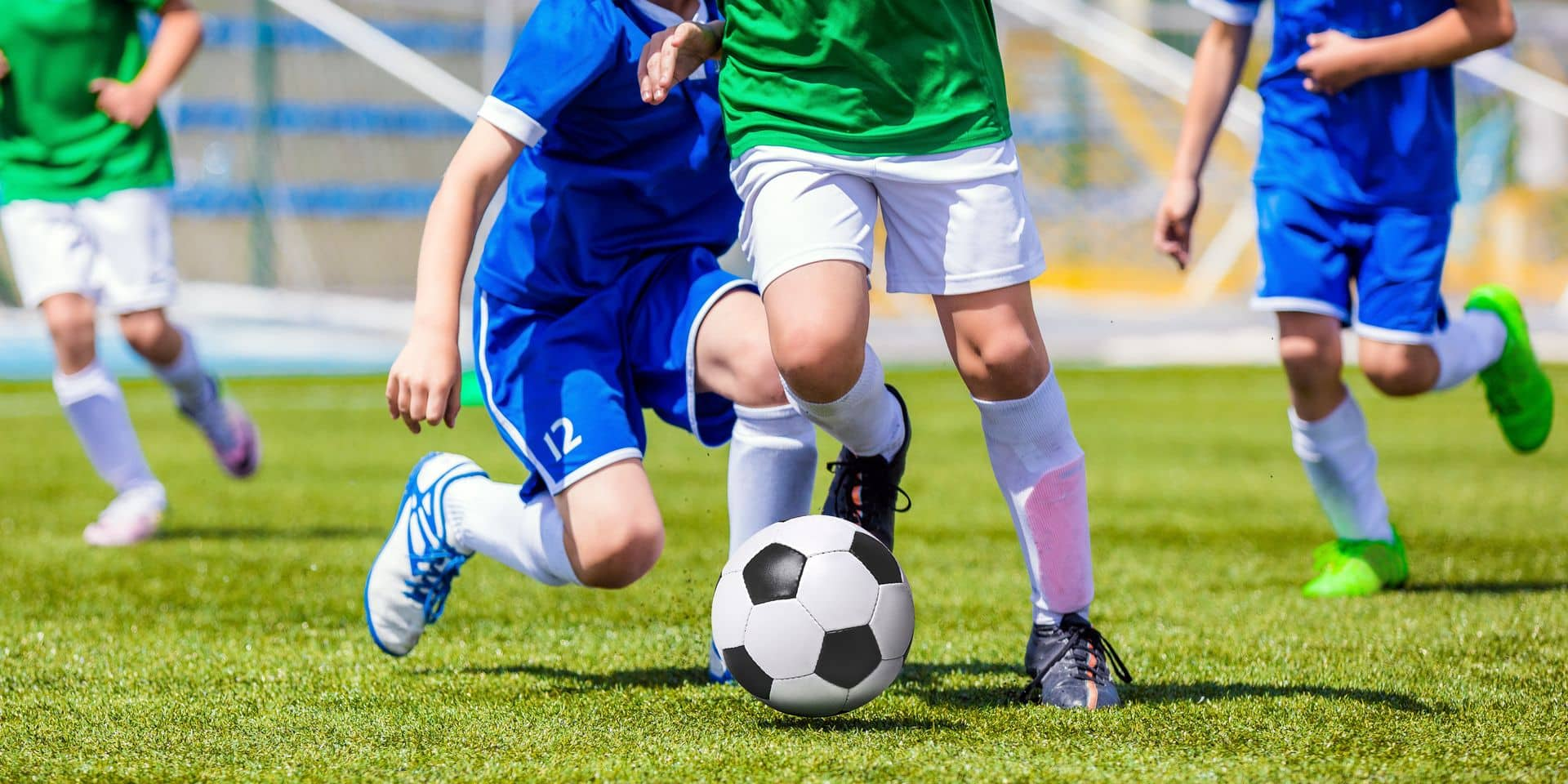 Running,Soccer,Football,Players.,Footballers,Kicking,Football,Match,Game.,Young