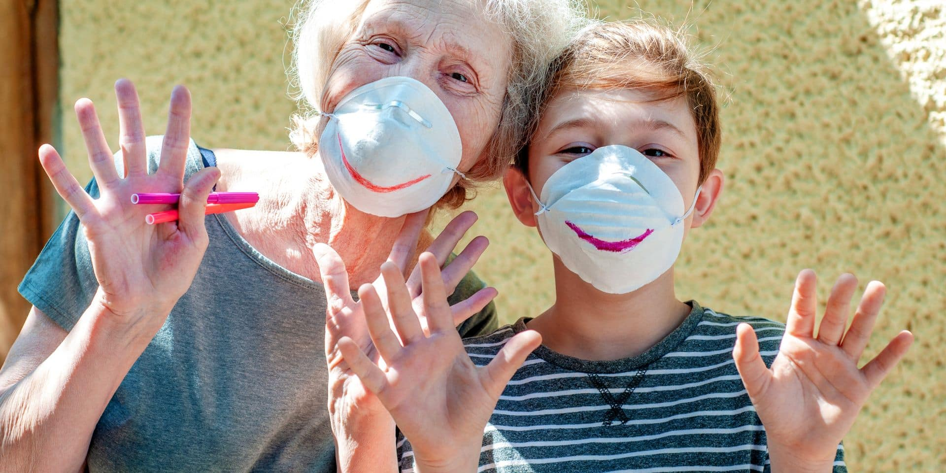 Happy,Laughing,Grandmother,With,Grandchild,In,A,Respiratory,Masks,Plays