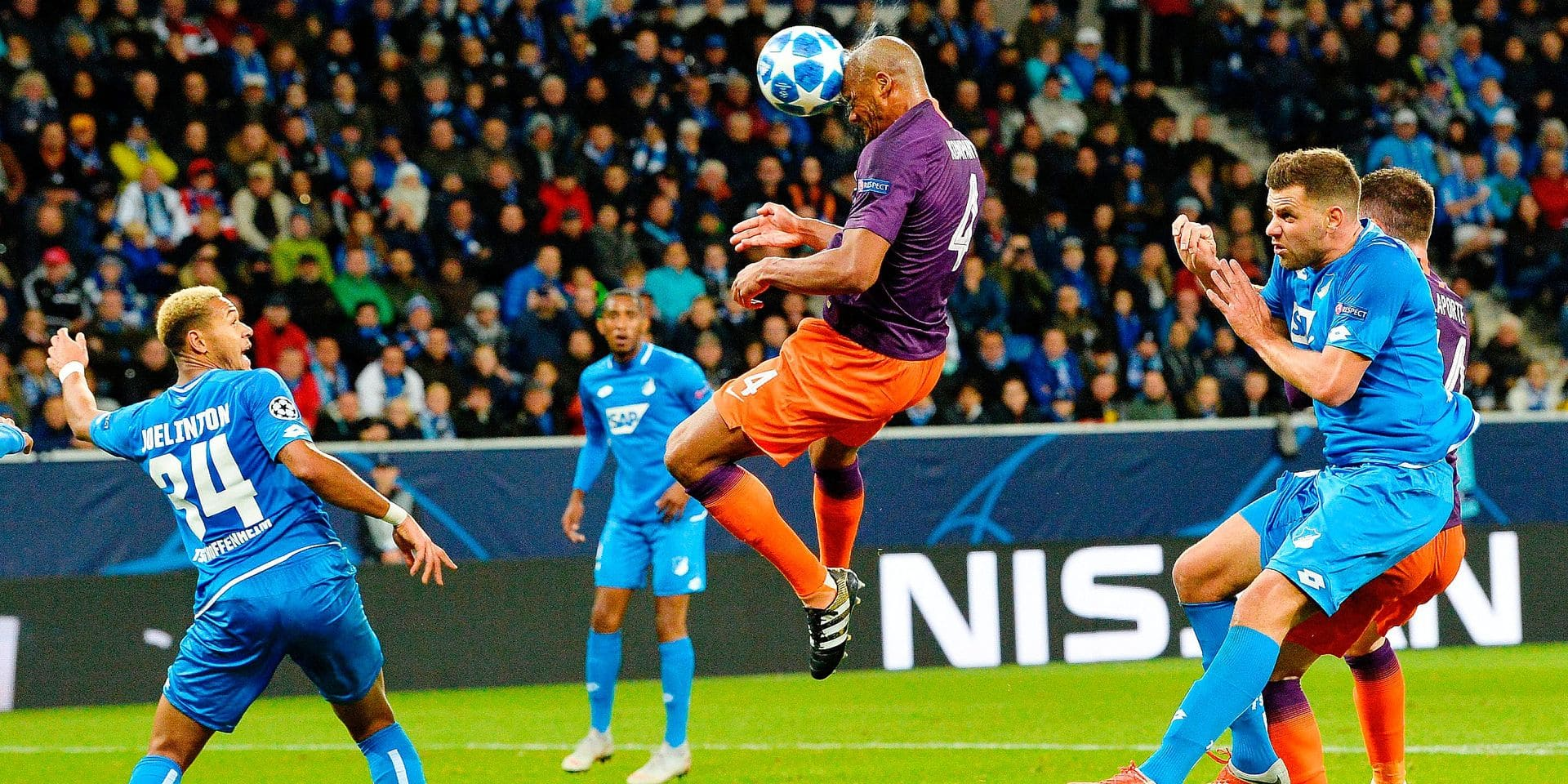 Manchester City's Belgian defender Vincent Kompany (C) heads the ball during the UEFA Champions League group F football match between TSG 1899 Hoffenheim and Manchester City at the Rhein-Neckar-Arena in Sinsheim, southwestern Germany, on October 2, 2018. (Photo by Thomas KIENZLE / AFP)