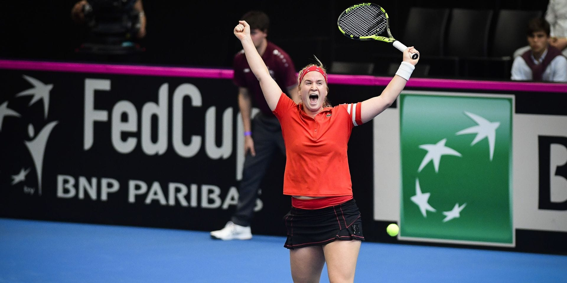Belgian Ysaline Bonaventure celebrates after winning the third game of the Fed Cup World Group play-offs tennis game between Belgium and Spain, with Belgian Bonaventure and Spanish Muguruza, Sunday 21 April 2019 in Kortrijk. BELGA PHOTO LAURIE DIEFFEMBACQ