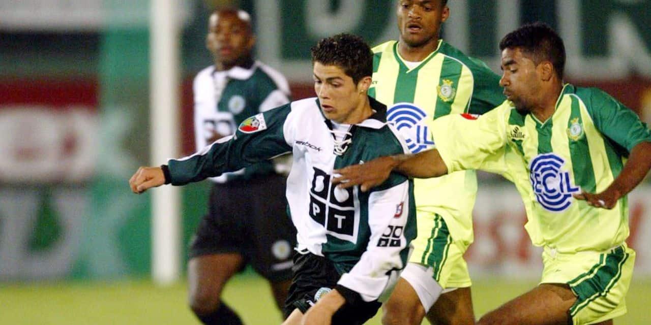 Sporting's Cristiano Ronaldo fights for the ball with Setubal's Jorginho