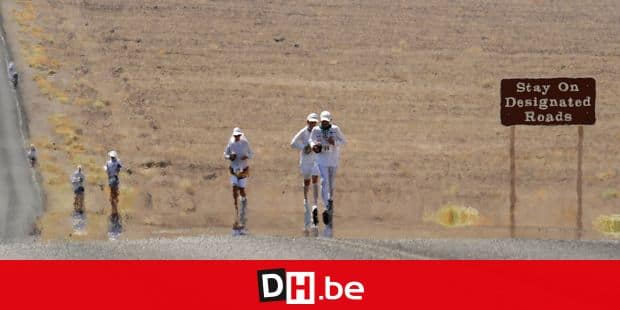 Competitors appear to shimmer as they run on the 145F pavement, in the 2008 Badwater Ultramarathon, in Death Valley, California on July 14, 2008. With air temperatures reaching as high as 130F (55C), the 135 miles (217 km) course crosses desert as low as 280 feet (85 m) below sea level at Badwater on the way to the Mt. Witney Portal at 8,360 feet (2533m). The winner normally crosses the finish line in less than 24 hours, while the course stays open for 60 hours. AFP PHOTO / Robyn Beck (Photo by ROBYN BECK / AFP)