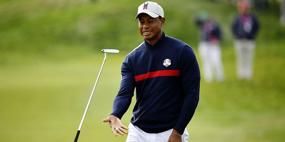 US golfer Tiger Woods juggles his putter during his fourball match on the first day of the 42nd Ryder Cup at Le Golf National Course at Saint-Quentin-en-Yvelines, south-west of Paris on September 28, 2018. (Photo by Eric FEFERBERG / AFP)