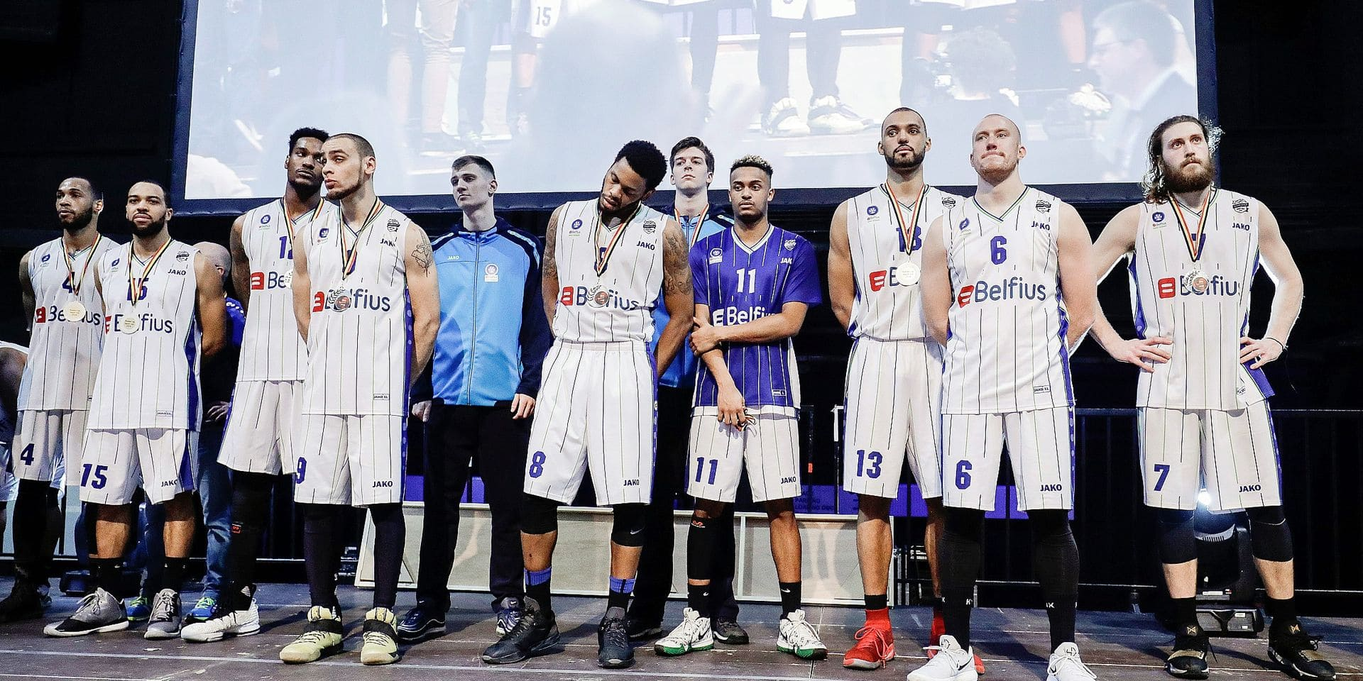 Mons' players pictured after the basketball match between BC Oostende and Mons-Hainaut, the final of the Belgian Bpost Cup competition, Sunday 11 March 2018 in Brussels. BELGA PHOTO THIERRY ROGE