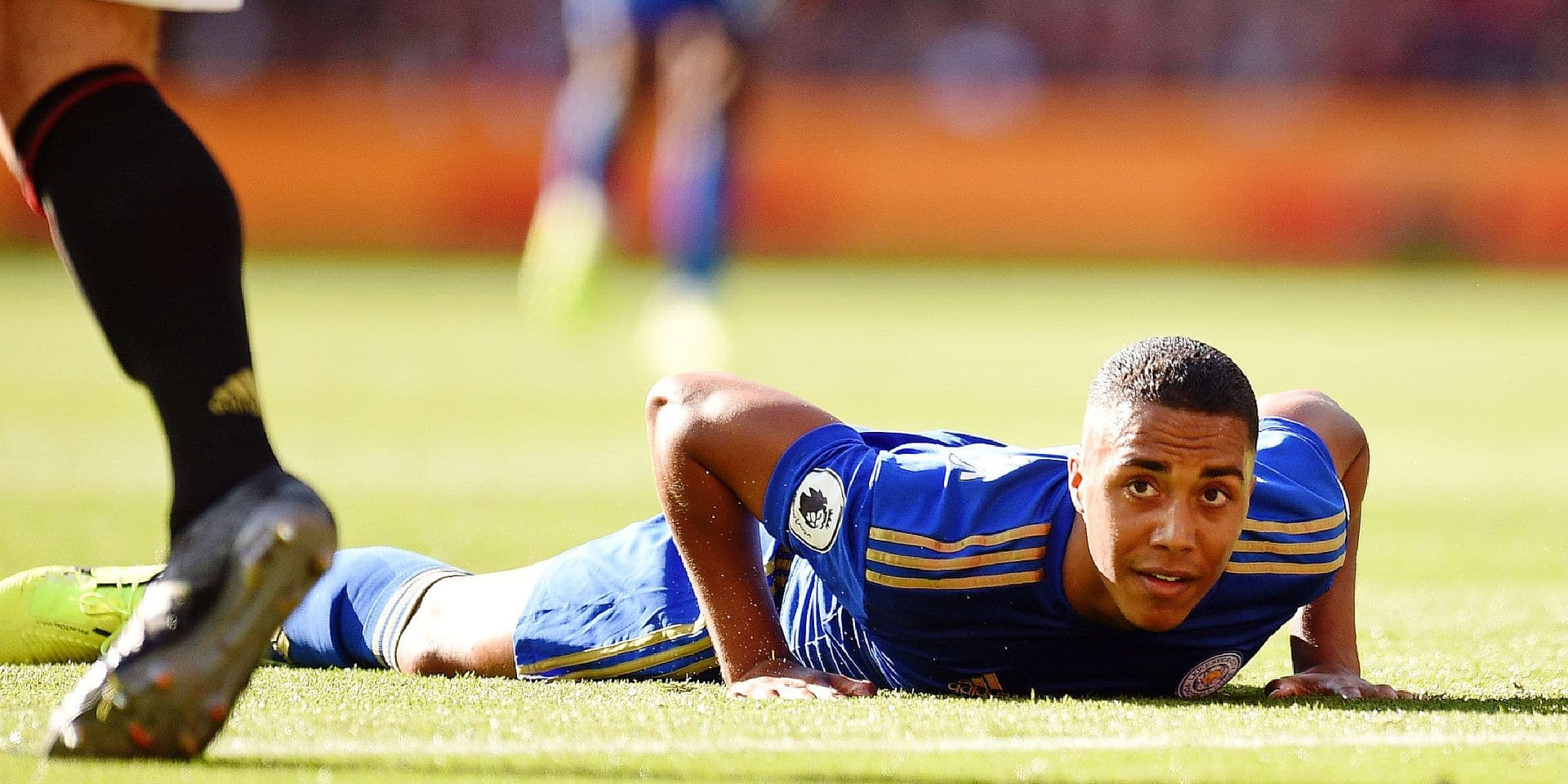 Leicester City's Belgian midfielder Youri Tielemans looks up during the English Premier League football match between Manchester United and Leicester City at Old Trafford in Manchester, north west England, on September 14, 2019. (Photo by Oli SCARFF / AFP) / RESTRICTED TO EDITORIAL USE. No use with unauthorized audio, video, data, fixture lists, club/league logos or 'live' services. Online in-match use limited to 120 images. An additional 40 images may be used in extra time. No video emulation. Social media in-match use limited to 120 images. An additional 40 images may be used in extra time. No use in betting publications, games or single club/league/player publications. /