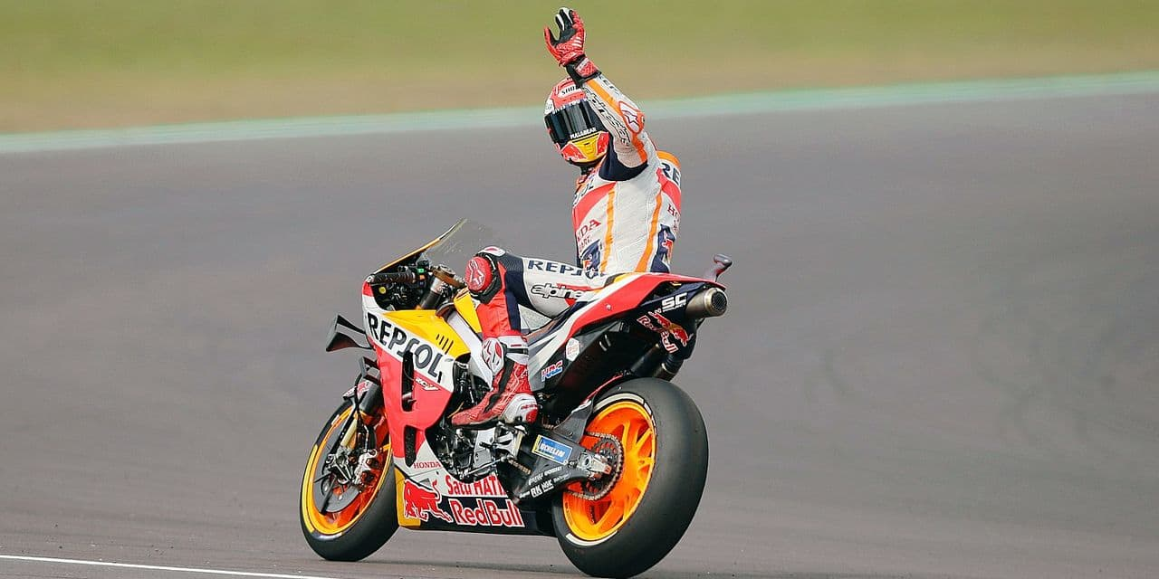 Marc Marquez of Spain greets spectators after winning the first position, during a Moto GP qualifying run at the Termas de Rio Hondo circuit in Argentina, Saturday, March 30, 2019. (AP Photo/Nicolas Aguilera)