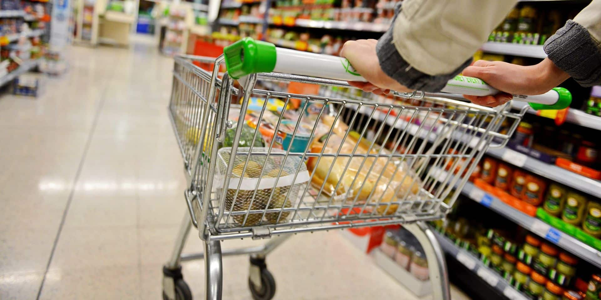 A,Shopper,Pushes,A,Trolley,Along,A,Supermarket,Aisle,-