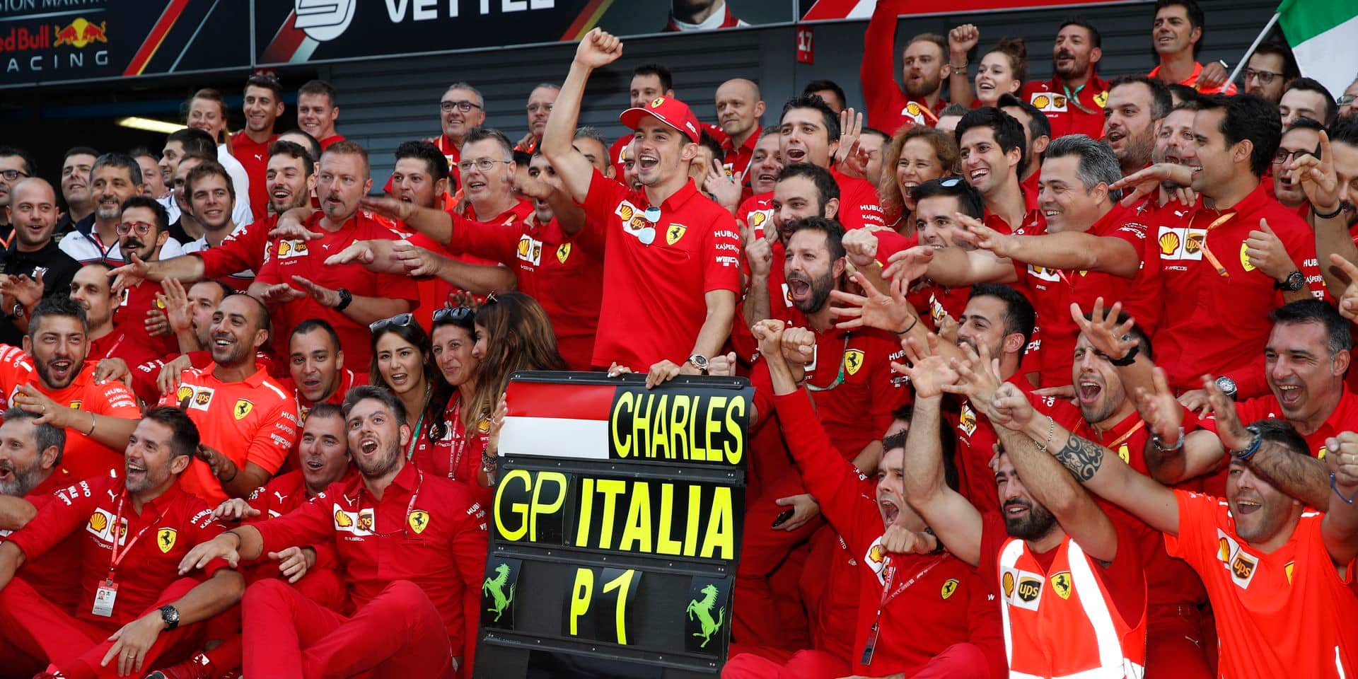 Ferrari driver Charles Leclerc of Monaco celebrates with Ferrari team staff at pits, after winning the Formula One Italy Grand Prix at the Monza racetrack, in Monza, Italy, Sunday, Sept.8, 2019. (AP Photo/Antonio Calanni)