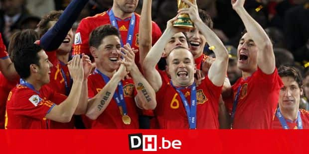 Spain's Andres Iniesta, second from right, holds up the World Cup trophy as team members celebrate at the end of the World Cup final soccer match between the Netherlands and Spain at Soccer City in Johannesburg, South Africa, Sunday, July 11, 2010. Spain won 1-0. (AP Photo/Bernat Armangue)