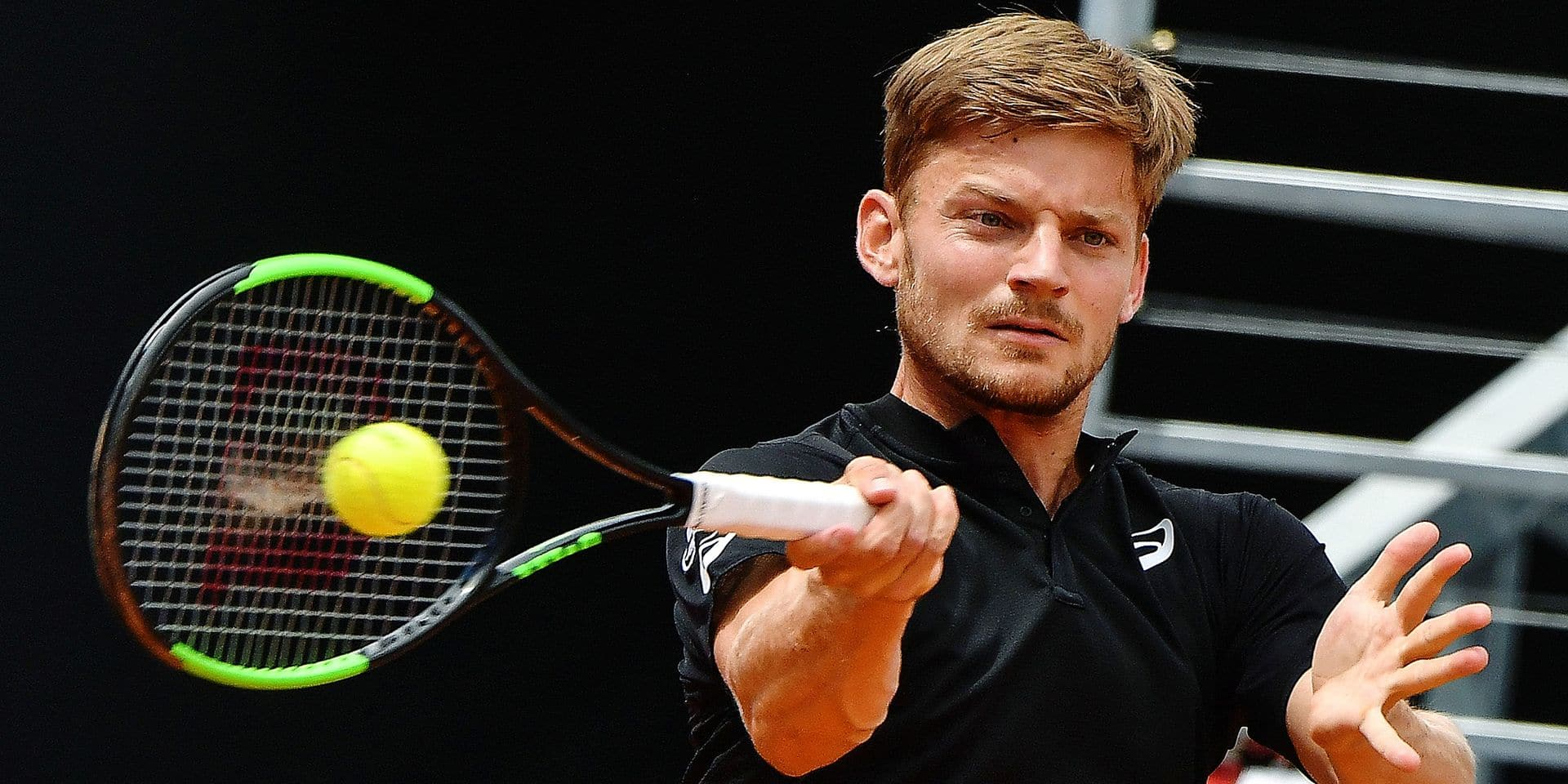 Belgium's David Goffin returns a shot to Switzerland's Stan Wawrinka during their ATP Masters tournament tennis match on May 14, 2019 at the Foro Italico in Rome. (Photo by Andreas SOLARO / AFP)