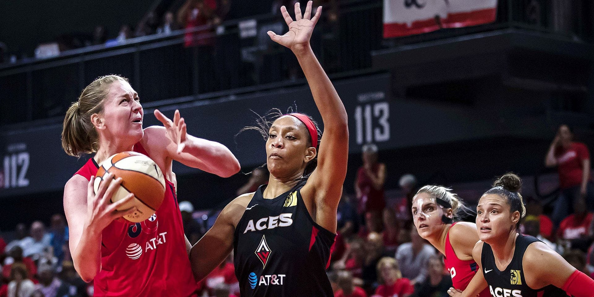 WASHINGTON, DC - SEPTEMBER 17: Emma Meesseman #33 of the Washington Mystics drives to the basket against A'ja Wilson #22 of the Las Vegas Aces during the second half of Game One of the 2019 WNBA playoffs at St Elizabeths East Entertainment & Sports Arena on September 17, 2019 in Washington, DC. NOTE TO USER: User expressly acknowledges and agrees that, by downloading and or using this photograph, User is consenting to the terms and conditions of the Getty Images License Agreement. Scott Taetsch/Getty Images/AFP == FOR NEWSPAPERS, INTERNET, TELCOS & TELEVISION USE ONLY ==