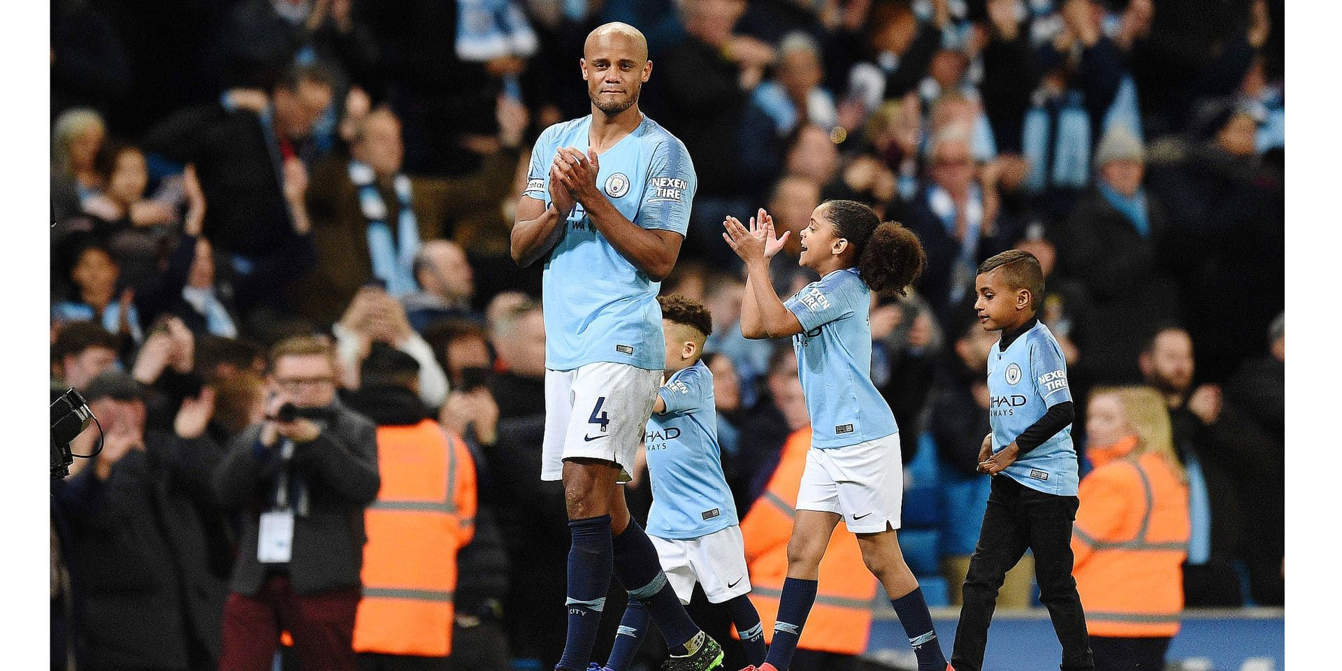 Manchester City's Belgian defender Vincent Kompany takes part in a lap of appreciation after the final whistle of the English Premier League football match between Manchester City and Leicester City at the Etihad Stadium in Manchester, north west England, on May 6, 2019. (Photo by Oli SCARFF / AFP) / RESTRICTED TO EDITORIAL USE. No use with unauthorized audio, video, data, fixture lists, club/league logos or 'live' services. Online in-match use limited to 120 images. An additional 40 images may be used in extra time. No video emulation. Social media in-match use limited to 120 images. An additional 40 images may be used in extra time. No use in betting publications, games or single club/league/player publications. /