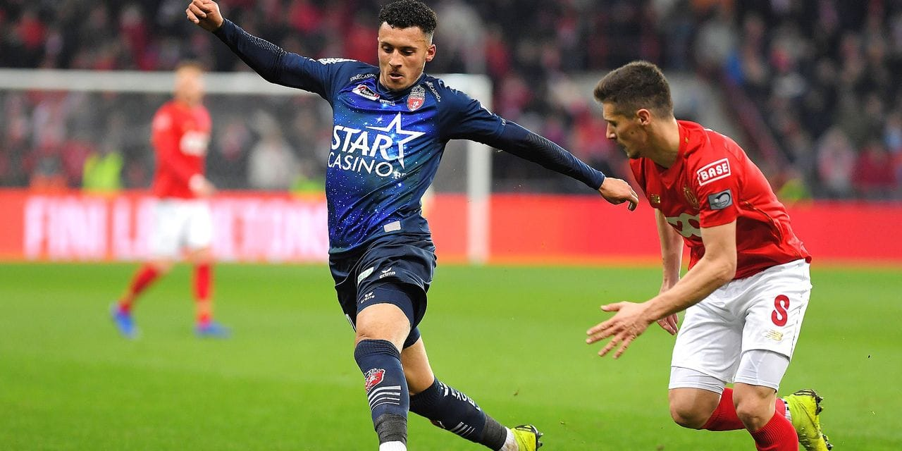 Mouscron's Selim Amallah and Standard's Gojko Cimirot fight for the ball during a soccer game between Standard de Liege and Royal Excel Mouscron, Saturday 02 March 2019 in Liege, on the 28th day of the 'Jupiler Pro League' Belgian soccer championship season 2018-2019. BELGA PHOTO LUC CLAESSEN
