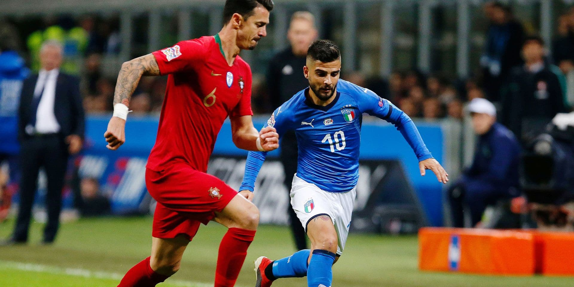 Italy's Lorenzo Insigne, right, and Portugal's Jose Fonte vie for the ball during the UEFA Nations League soccer match between Italy and Portugal at the San Siro Stadium, in Milan, Saturday, Nov. 17, 2018. (AP Photo/Antonio Calanni)