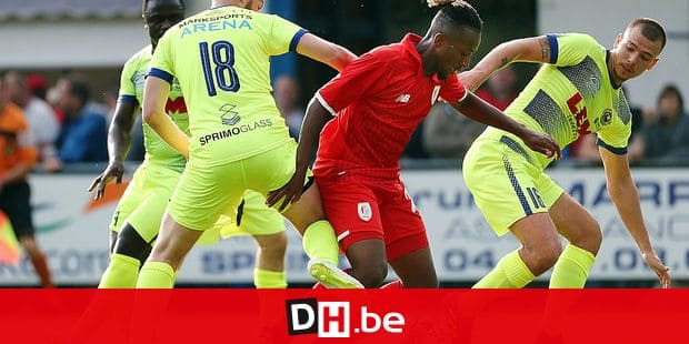 Sprimont's Jeremie Czagiel and Standard's Samuel Bastien fight for the ball during a friendly game, the first of the new season 2018-2019 for Standard de Liege, against FRCB Sprimont, in Sprimont, Saturday 23 June 2018. BELGA PHOTO VIRGINIE LEFOUR