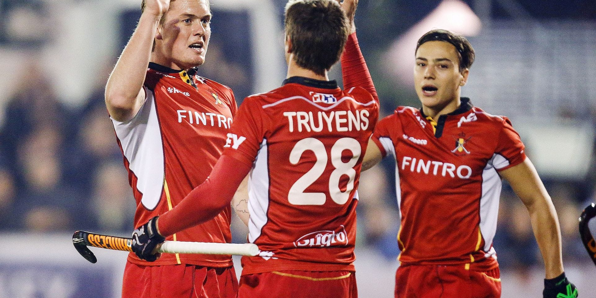 Red lions' Tom Boon, Red lions' Jerome Truyens and Red lions' Thomas Briels celebrate after scoring during a friendly game between Belgian Red Lions and Argentina, in Uccle sport, Wednesday 26 October 2016, in Brussels. The game is a remake of Rio olympic final, won by Argentina. 9200 seats where sold for the game, a reccord for hockey in Belgium. BELGA PHOTO THIERRY ROGE