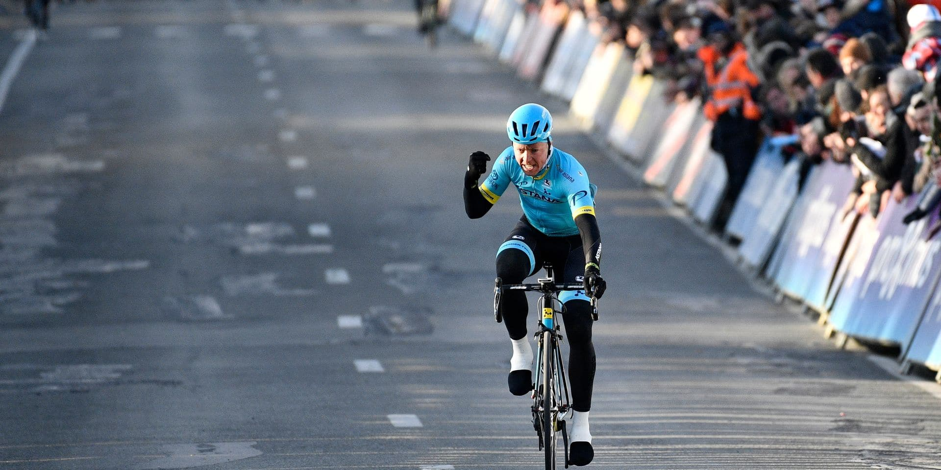 Danish Michael Valgren Andersen of Astana Pro Team celebrates as he crosses the finish line to win the Men's 2018 edition of the one-day cycling race Omloop Het Nieuwsblad, 196,2 km from Ghent to Ninove, Saturday 24 February 2018. BELGA PHOTO YORICK JANSENS