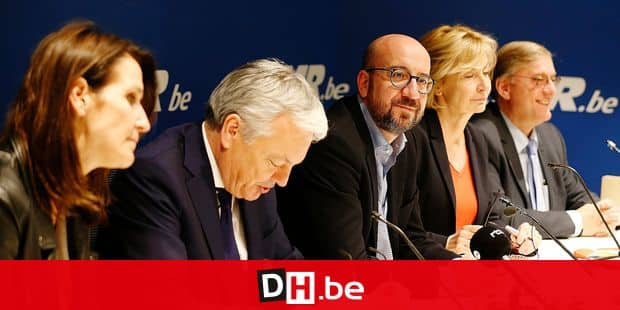 L-R, Minister of Budget Sophie Wilmes, Vice-Prime Minister and Minister of Foreign Affairs and Defence Didier Reynders, Belgian Prime Minister Charles Michel, MR's Francoise Schepmans and MR's head of group Vincent De Wolf pictured at a press conference at the headquarters of French-speaking liberals MR, in Brussels, Saturday 23 March 2019. BELGA PHOTO NICOLAS MAETERLINCK