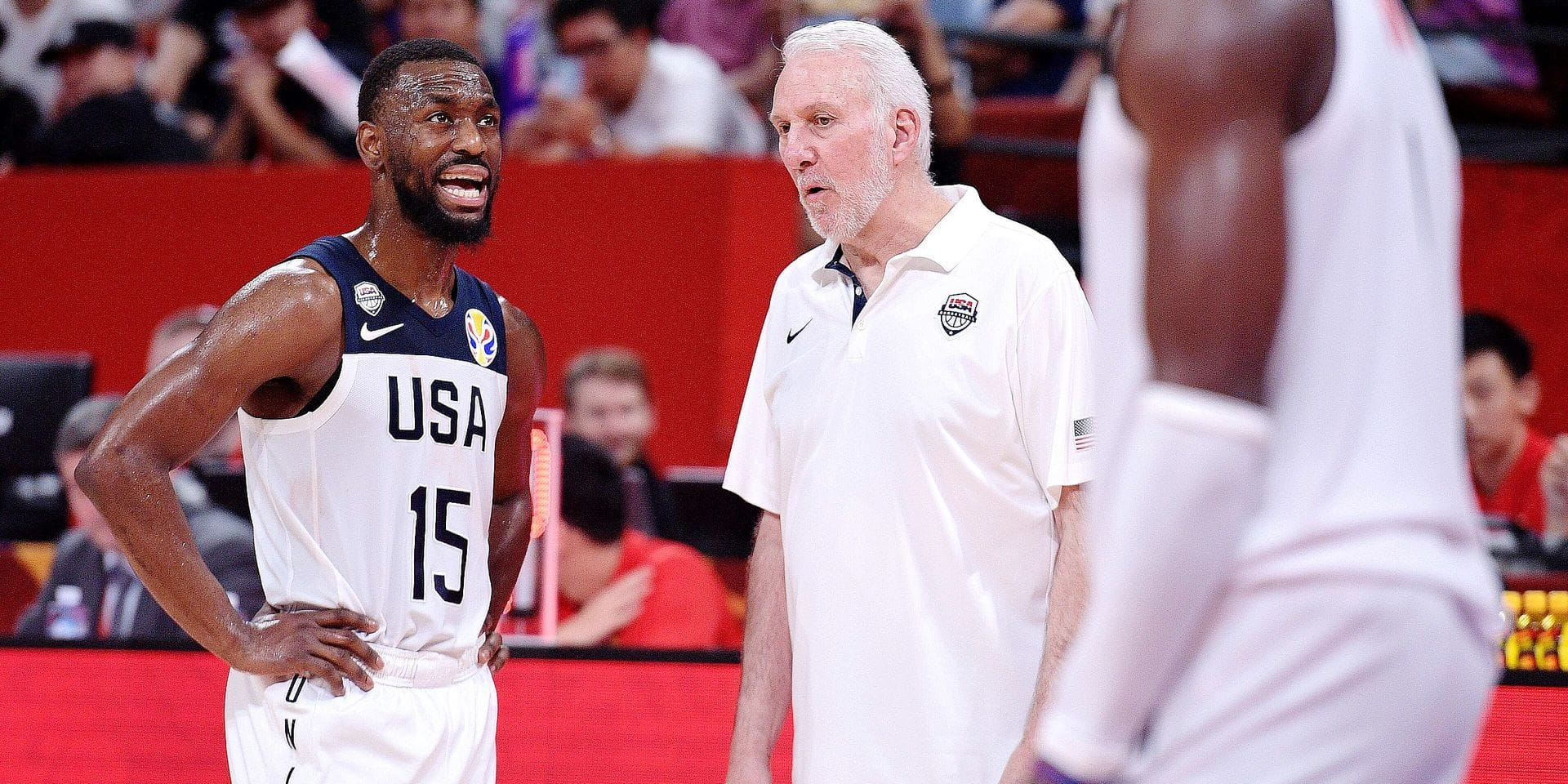 Kemba Walker (L) of the US speaks to his team's coach Gregg Popovich during the Basketball World Cup Group K second round game between US and Brazil in Shenzhen on September 9, 2019. (Photo by Nicolas ASFOURI / AFP)