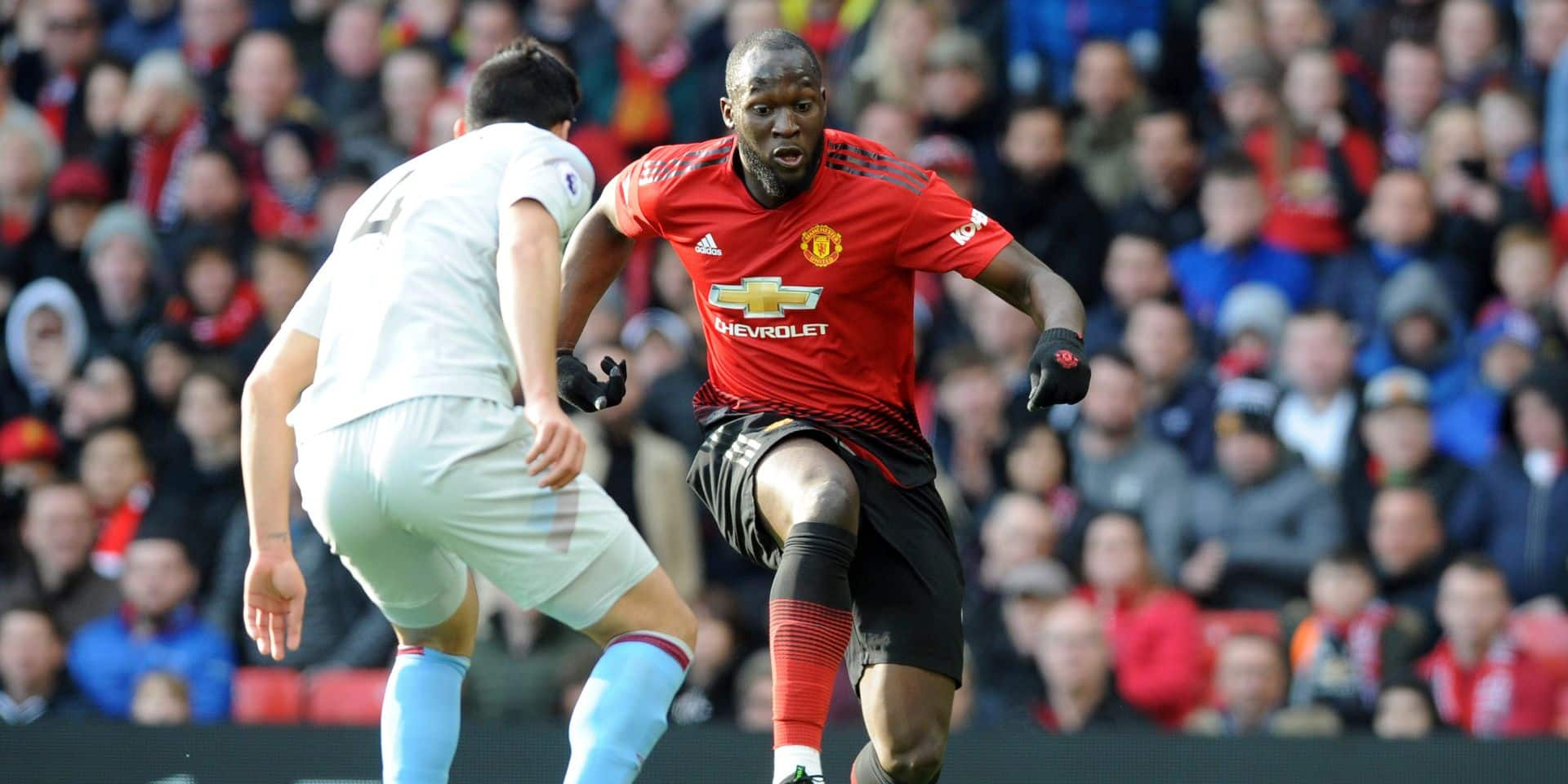 Manchester United's Romelu Lukaku vies for the ball with West Ham's Fabian Balbuena, left, during the English Premier League soccer match between Manchester United and West Ham United at Old Trafford in Manchester, England, Saturday, April 13, 2019. (AP Photo/Rui Vieira)
