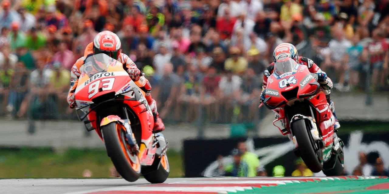 Repsol Honda Team's Spanish rider Marc Marquez (L) and Mission Winnow Ducati's Italian rider Andrea Dovizioso ride their motorbikes during the race of the Austrian Moto GP Grand Prix in Spielberg on August 11, 2019 (Photo by VLADIMIR SIMICEK / AFP)