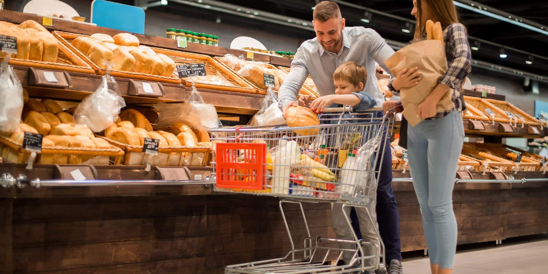 Full,Length,Portrait,Of,Happy,Young,Family,Shopping,For,Groceries