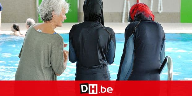 FILE - A file photo dated 23 June 2009 shows two Muslim pupils of the Vigelius school wearing a full-body swimsuit next to their teacher Renate Scherf at the swimming pool in Freiburg, Germany. In order to facilitate the participation of Muslim pupils in swimming lessons, the teacher of the Vigelius school got the black full-body suits. After all, ten students from different classes take part in the swimming lessons in the so-called 'Burqini'. Photo: ROLF HAID Reporters / DPA