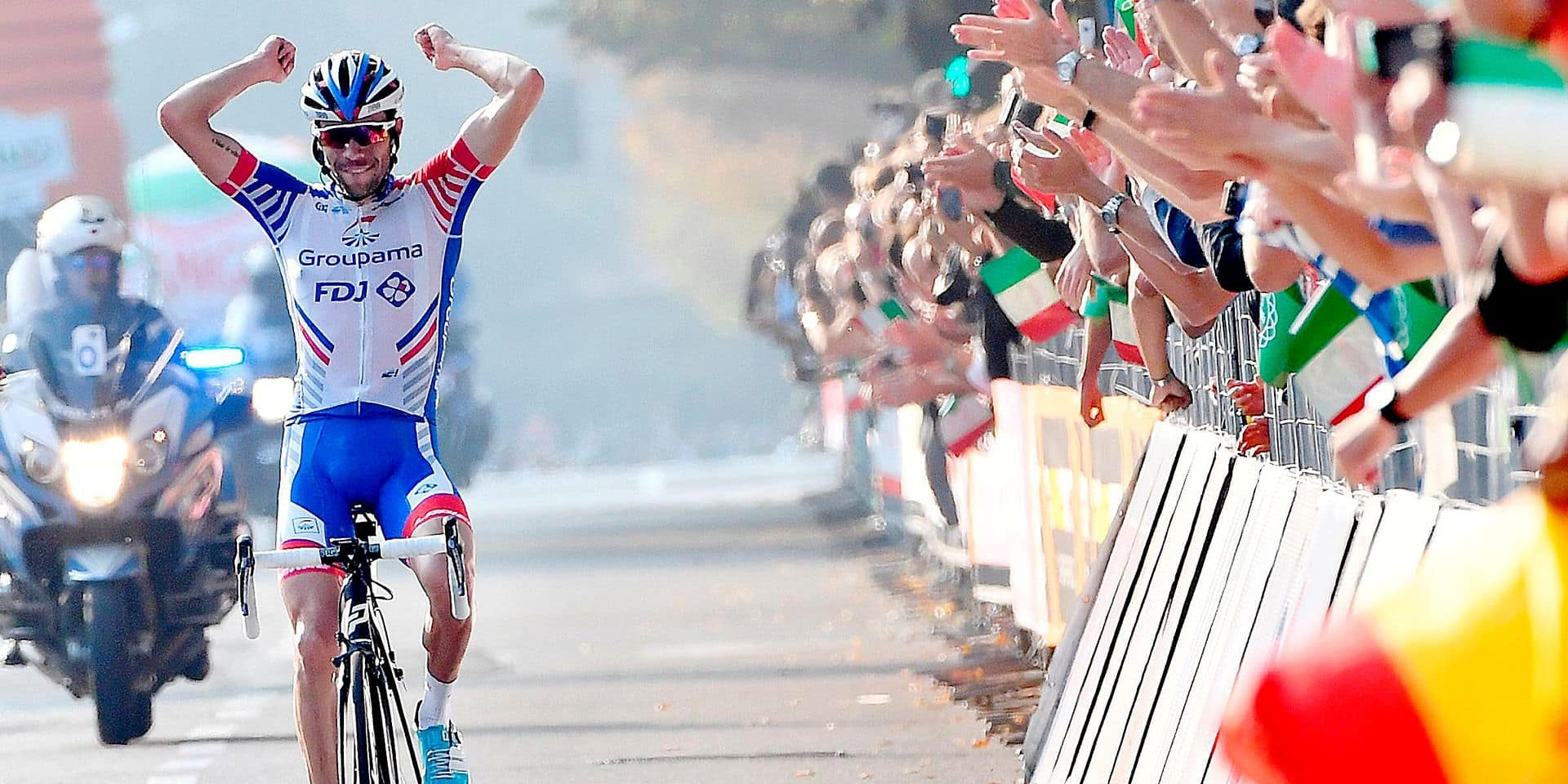 First placed, France's Thibaut Pinot celebrates as he crosses the finish line of the Giro di Lombardia cycling race in Como, Italy, Saturday, Oct. 13, 2018. (Daniel dal Zennaro/ANSA via AP)