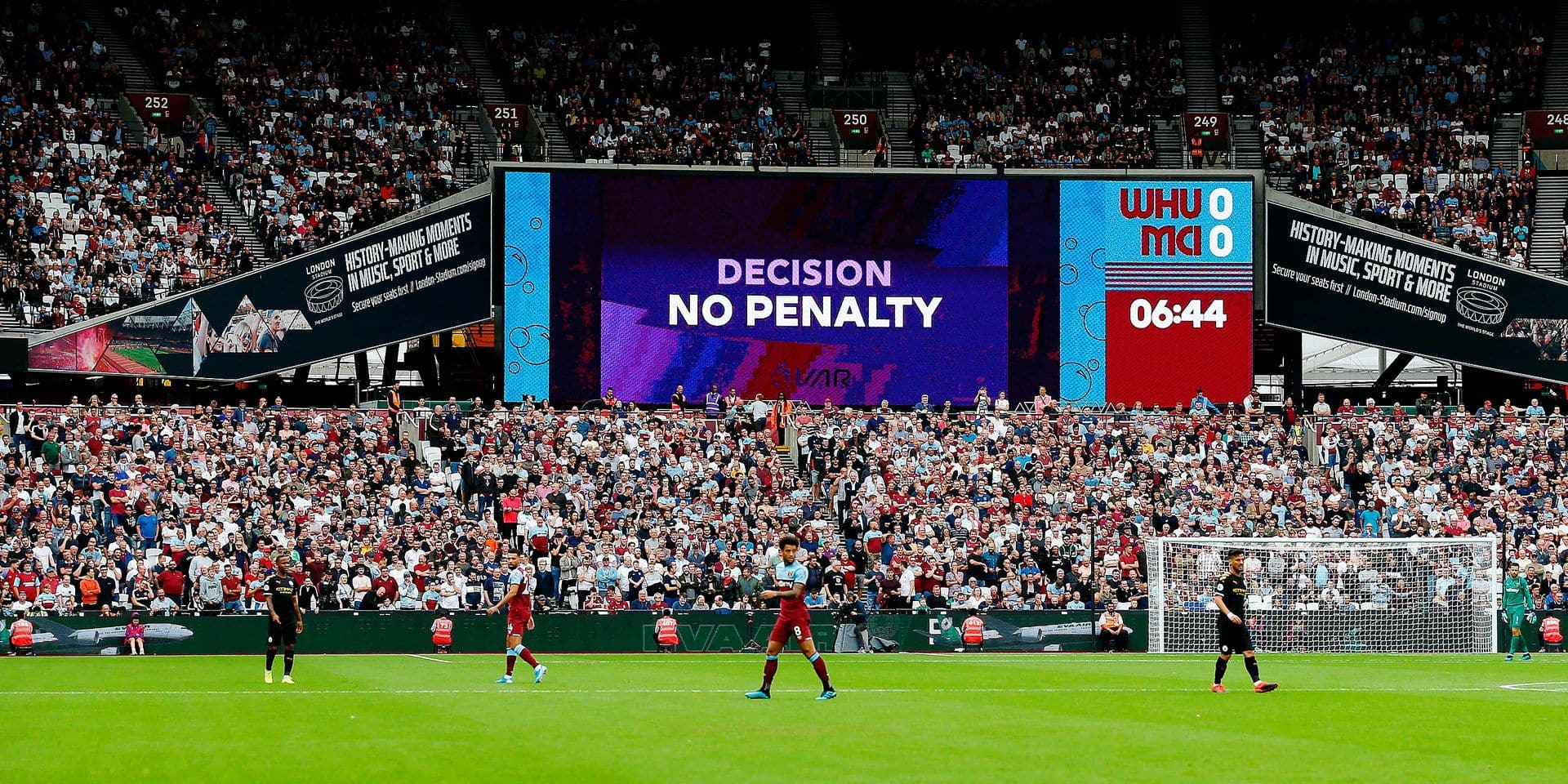 A big screen displays the VAR decision on a penalty shout during the English Premier League football match between West Ham United and Manchester City at The London Stadium, in east London on August 10, 2019. (Photo by Ian KINGTON / AFP) / RESTRICTED TO EDITORIAL USE. No use with unauthorized audio, video, data, fixture lists, club/league logos or 'live' services. Online in-match use limited to 120 images. An additional 40 images may be used in extra time. No video emulation. Social media in-match use limited to 120 images. An additional 40 images may be used in extra time. No use in betting publications, games or single club/league/player publications. /