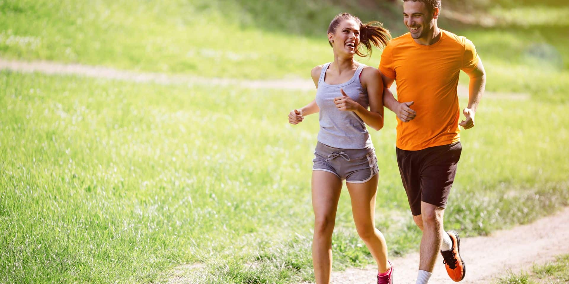 Couple,Jogging,And,Running,Outdoors,In,Nature
