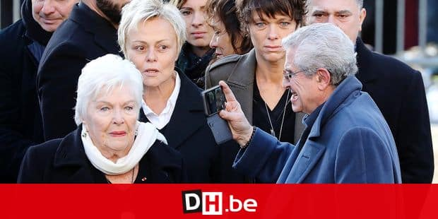 (From L) French singer Line Renaud, French comedian Muriel Robin and French film director Claude Lelouch arrive outside the La Madeleine Church at the start of the funeral ceremony in tribute to late French singer Johnny Hallyday on December 9, 2017 in Paris. French music icon Johnny Hallyday died on December 6, 2017 aged 74 after a battle with lung cancer, plunging the country into mourning for a national treasure whose soft rock lit up the lives of three generations. / AFP PHOTO / ludovic MARIN