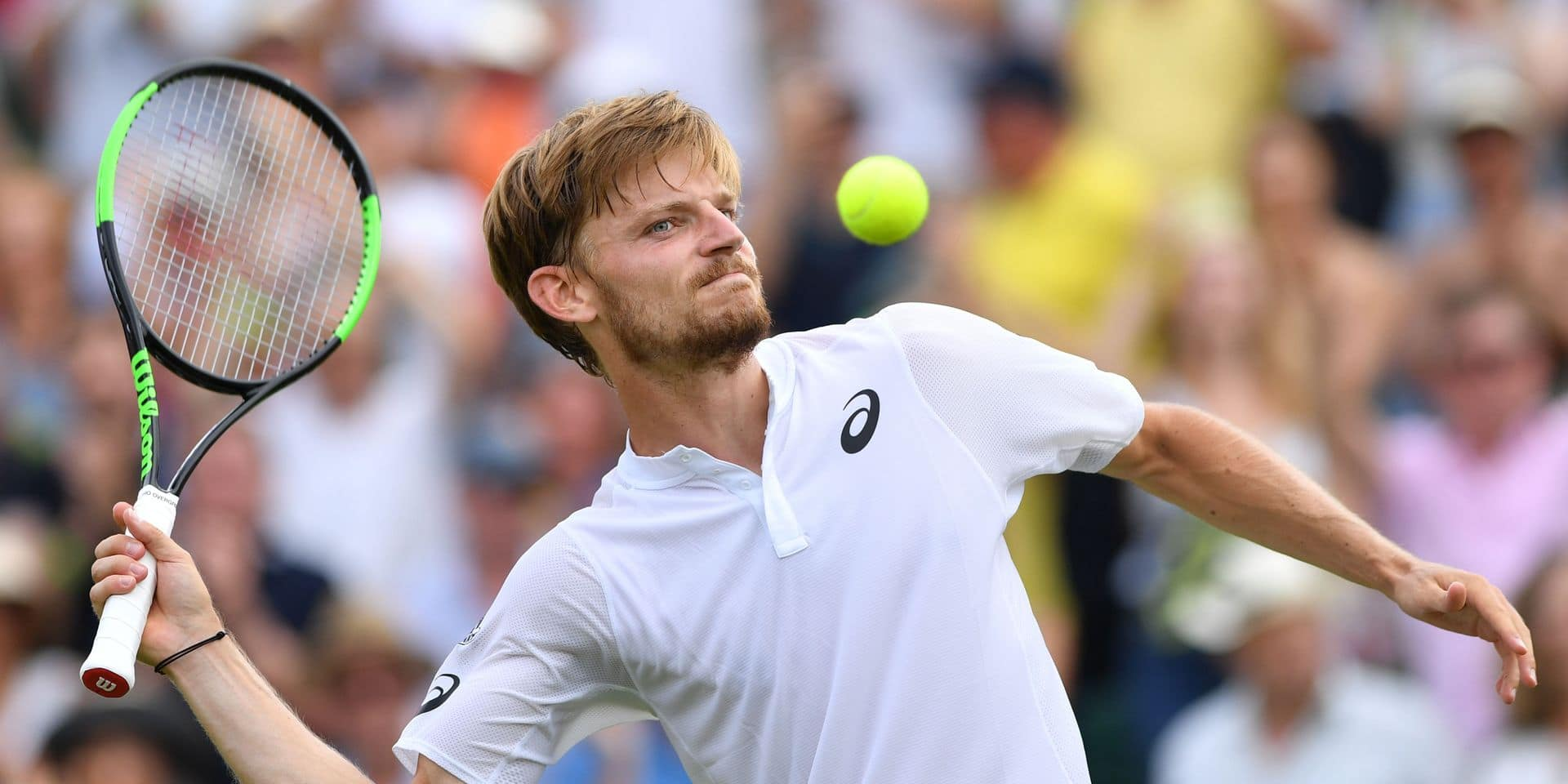 Belgium's David Goffin celebrates beating Russia's Daniil Medvedev during their men's singles third round match on the fifth day of the 2019 Wimbledon Championships at The All England Lawn Tennis Club in Wimbledon, southwest London, on July 5, 2019. (Photo by Glyn KIRK / AFP) / RESTRICTED TO EDITORIAL USE