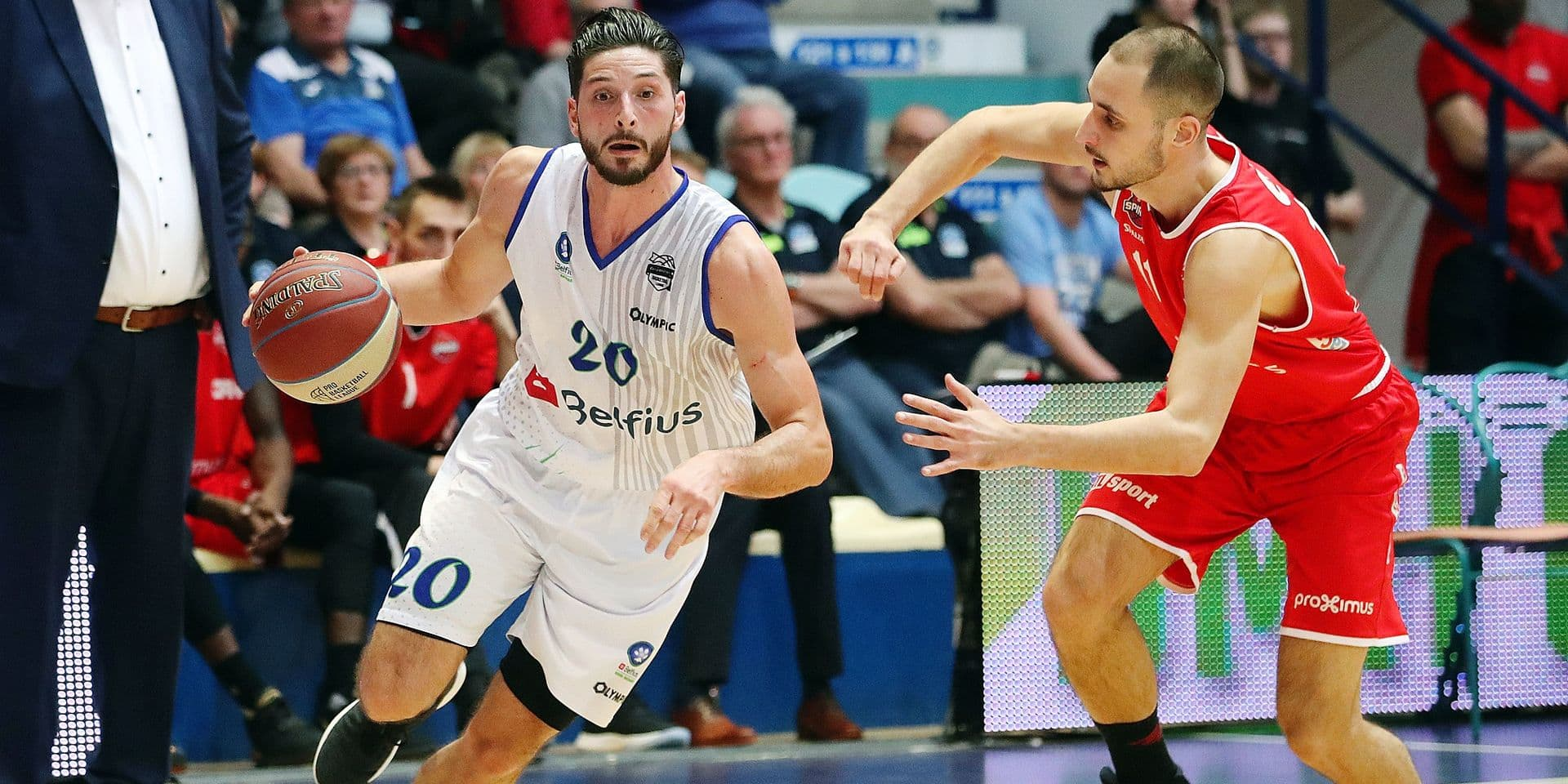 Mons' Lorenzo Giancaterino and Charleroi's Sami Demirtas fight for the ball during the basketball match between Mons-Hainaut and Spirou-Charleroi, Saturday 16 February 2019 in Mons, on day 17 of the 'EuroMillions League' Belgian first division basket competition. BELGA PHOTO VIRGINIE LEFOUR