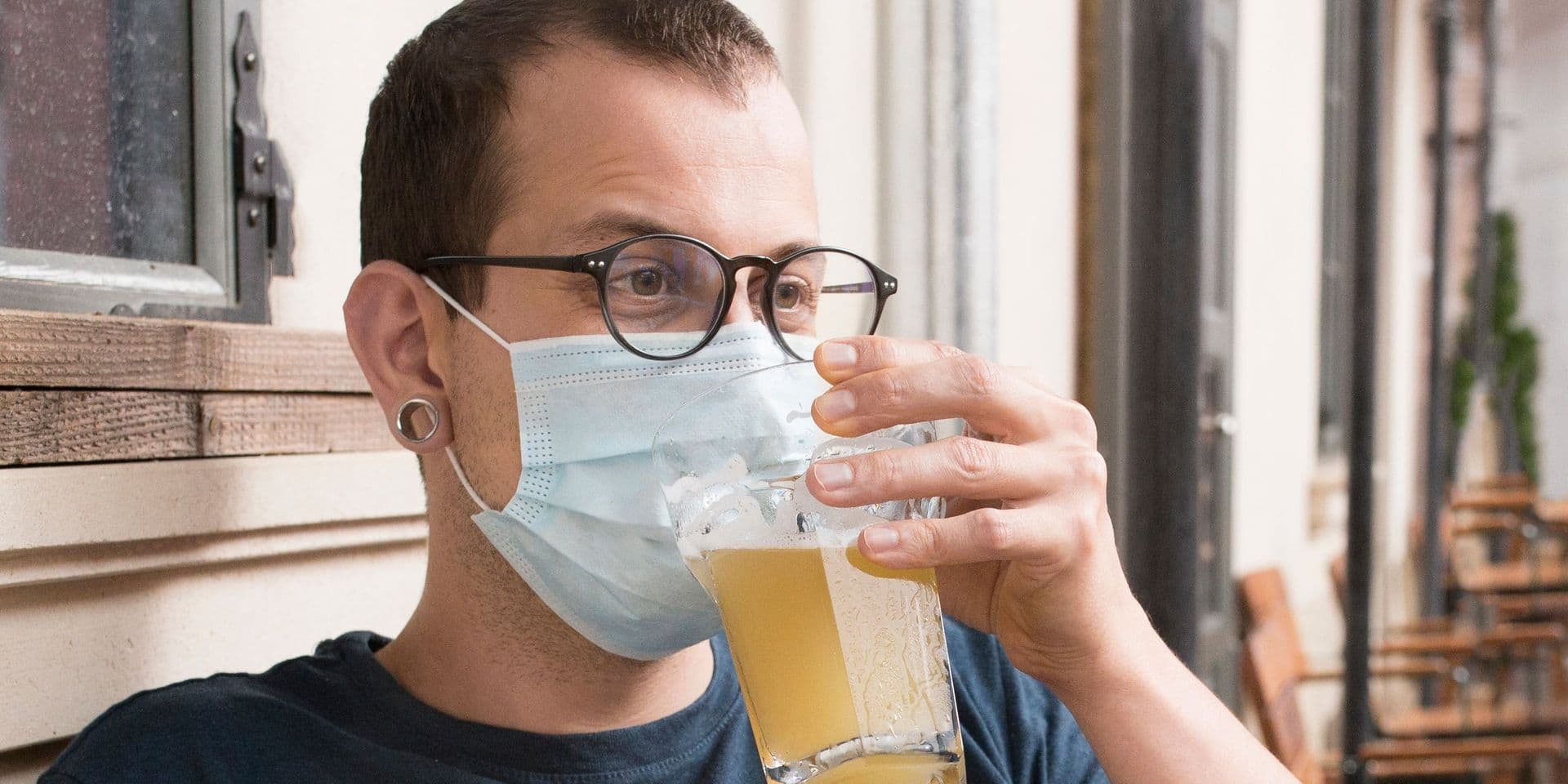 Young,Man,Wearing,Medical,Mask.,Drinking,Beer.,Restaurant,Or,Bar