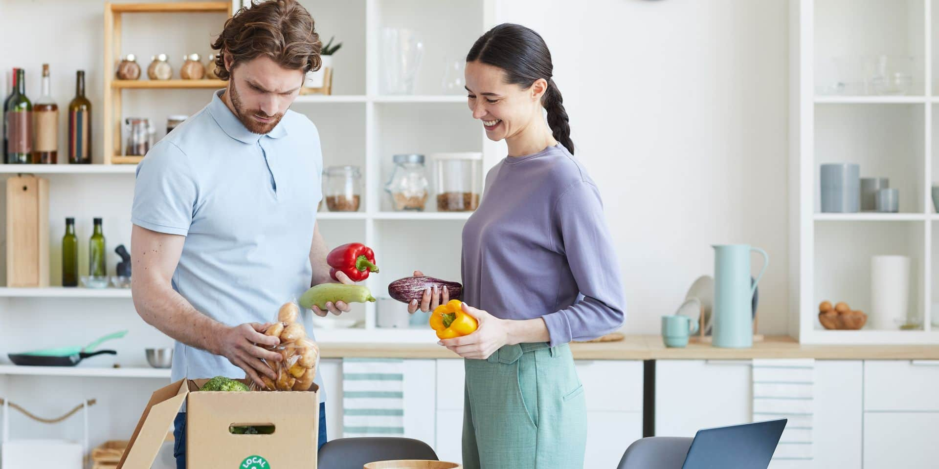 Young,Couple,Unpacking,Food,Together,From,The,Cardboard,Box,After