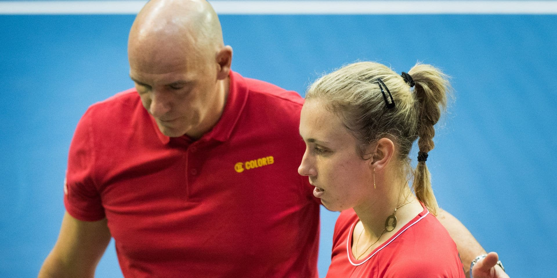 Belgian captain Johan Van Herck and Elise Mertens look dejected after a tennis match between Belgian Elise Mertens and French Caroline Garcia, the third rubber of the Fed Cup tennis meeting between Belgium and France, the quarter-finals of the World Group, Sunday 10 February 2019 in Liege. BELGA PHOTO BENOIT DOPPAGNE