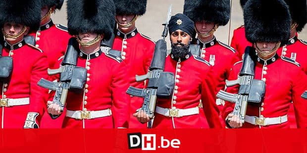 Charanpreet Singh Lall, second right, one of the Coldstream Guards marches, during the Trooping the Colour ceremony at Horse Guards Parade as Queen Elizabeth II celebrates her official birthday, in London, Saturday June 9, 2018. Lall is the first soldier to wear a turban during the Trooping the Colour parade. (Victoria Jones/PA via AP)