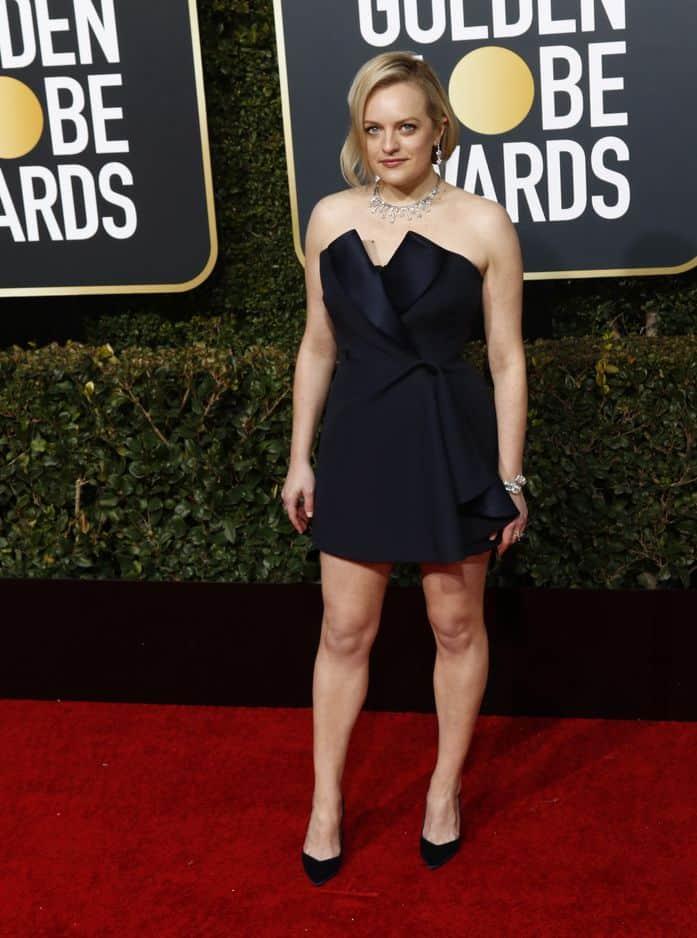 Elisabeth Moss, une des seules à porter une robe courte signée Christian Dior Haute Couture. Qu'elle changea par la suite pour une longue...