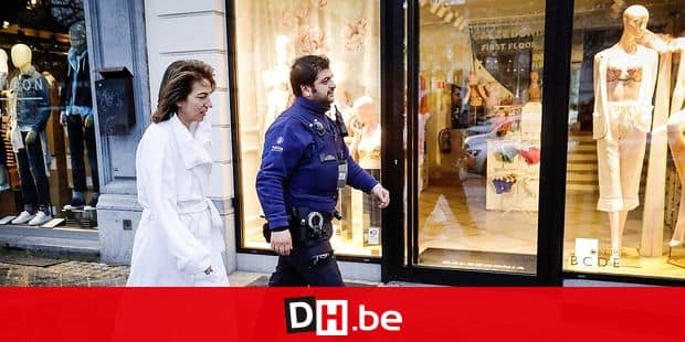 A police officer walks along with a client of the hotel back to the Sofitel Hotel Avenue de la Toison d'Or - Gulden Vlieslaan who was evacuated in the night as a fire started in a kitchen of the hotel on thefirst floor which brought lots of smoke, the 170 clients of the hotel were evacuated, in Brussels, Wednesday 13 March 2019. BELGA PHOTO THIERRY ROGE