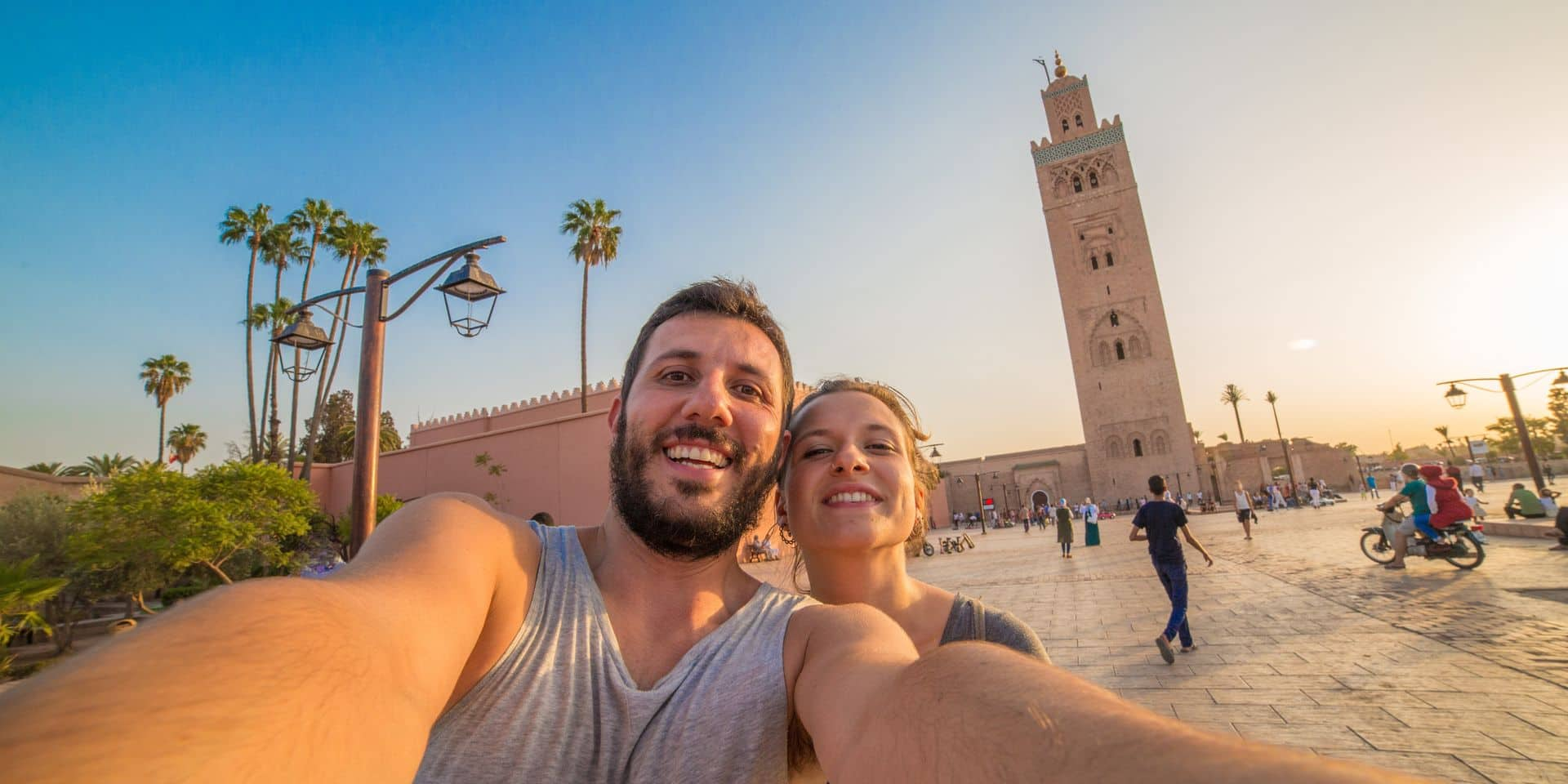 Happy,Smiling,Tourists,Take,Selfie,Photo,In,Front,Of,Koutoubia