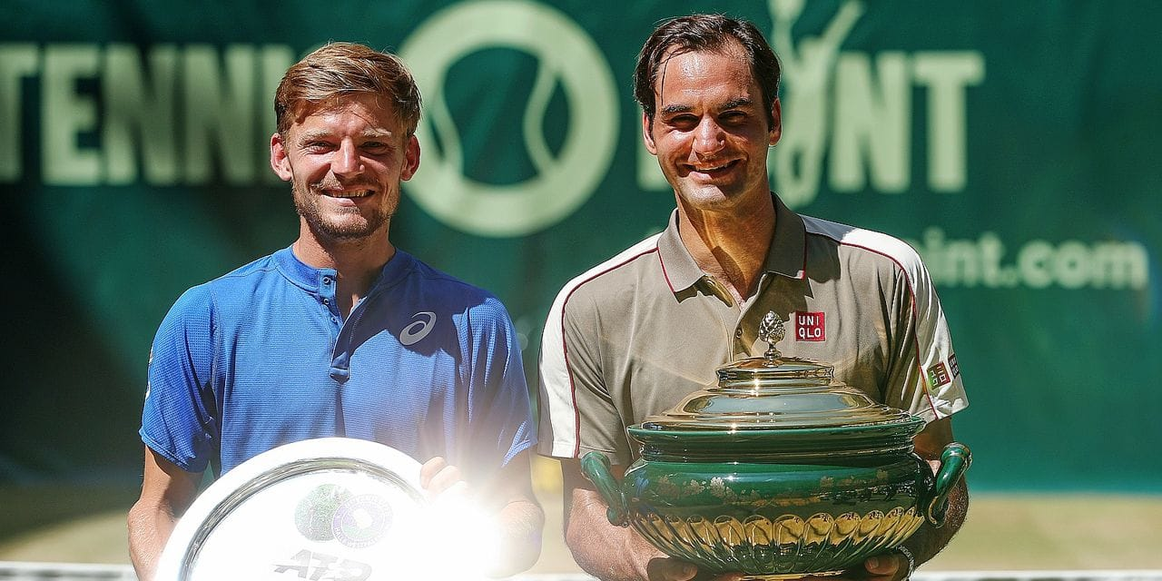 23 June 2019, North Rhine-Westphalia, Halle: Tennis: ATP-Tour singles, men, final, Federer (Switzerland) - Goffin (Belgium). Second placed David Goffin (l) stands next to the winner Roger Federer (r). Photo: Friso Gentsch/dpa Reporters / DPA