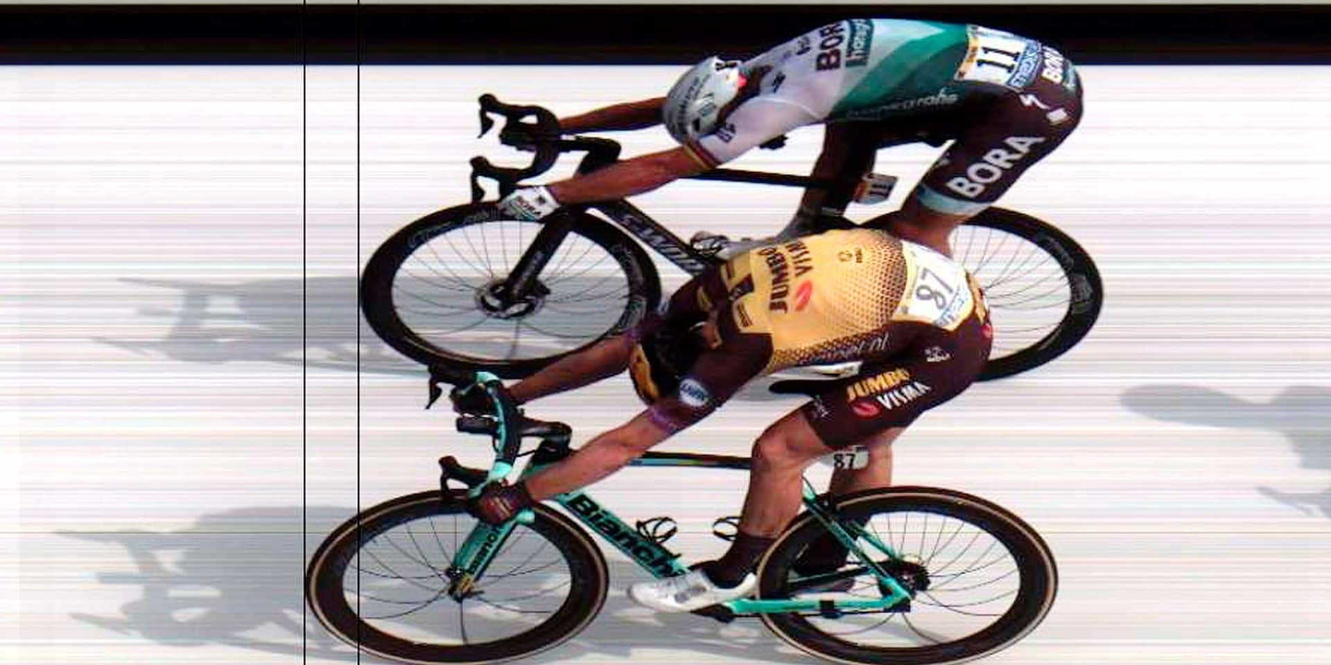 In this photo finish released by Amaury Sport Organization (ASO) Slovakia's Peter Sagan, top, and Netherlands' Mike Teunissen, cross the finish of the first stage of the Tour de France cycling race over 194.5 kilometers (120,86 miles) with start in Brussels and finish in Brussels. Saturday, July 6, 2019. Teunissen won the stage. (AP Photo/ASO)