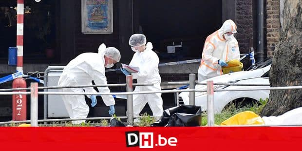 Forensic police investigate at the scene of a shooting in Liege, Belgium, Tuesday, May 29, 2018. A gunman killed three people, including two police officers, in the Belgian city of Liege on Tuesday, a city official said. Police later killed the attacker, and other officers were wounded in the shooting. (AP Photo/Geert Vanden Wijngaert)