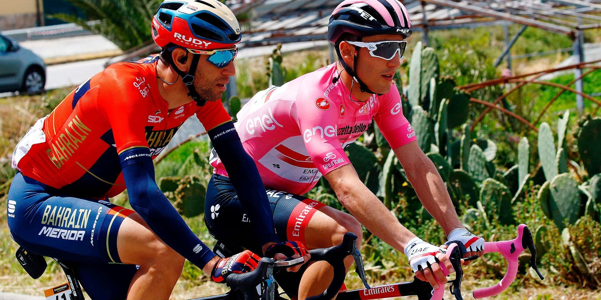 Team Bahrain rider Italy's Vincenzo Nibali (L) rides with Team UAE Emirates rider Italy's Valerio Conti, overall leader and Pink Jersey holder, as they take part in stage eight of the 102nd Giro d'Italia - Tour of Italy - cycle race, 239kms from Tortoreto Lido to Pesaro on May 18, 2019. (Photo by Luk BENIES / AFP)