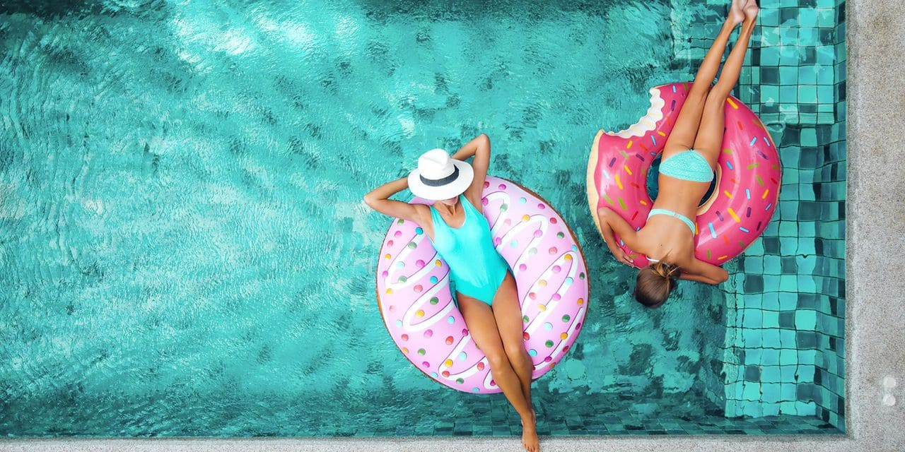 Two,People,(mom,And,Child),Relaxing,On,Donut,Lilo,In
